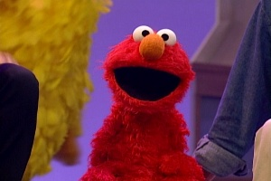 Elmo sings along in Elmopalooza.