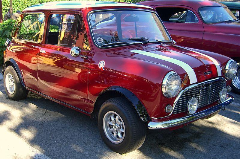 a 1961 red and white mini cooper