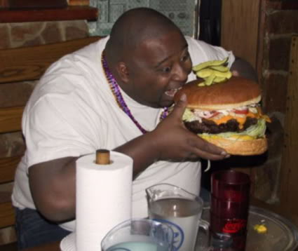 [Image: Fat-guy-eating-giant-hamburger.jpg]