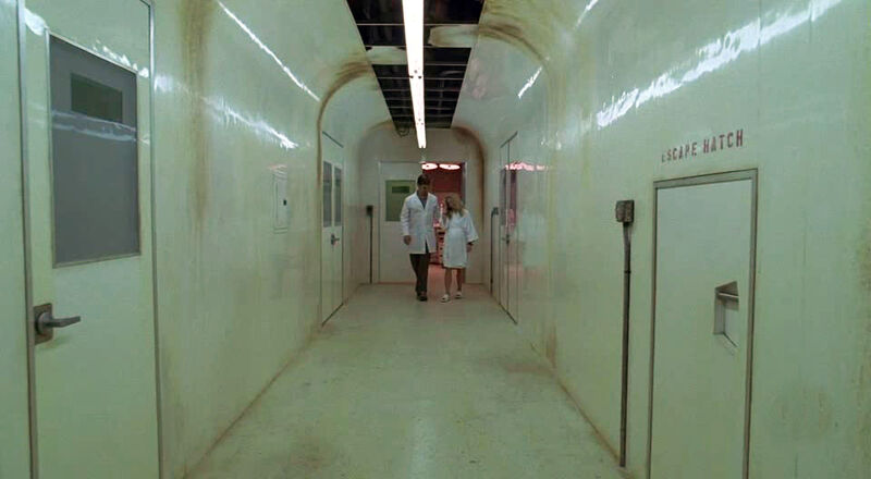 Ethan and Claire Walk Down a Corridor